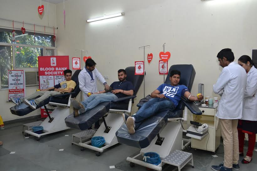 Youngsters giving blood